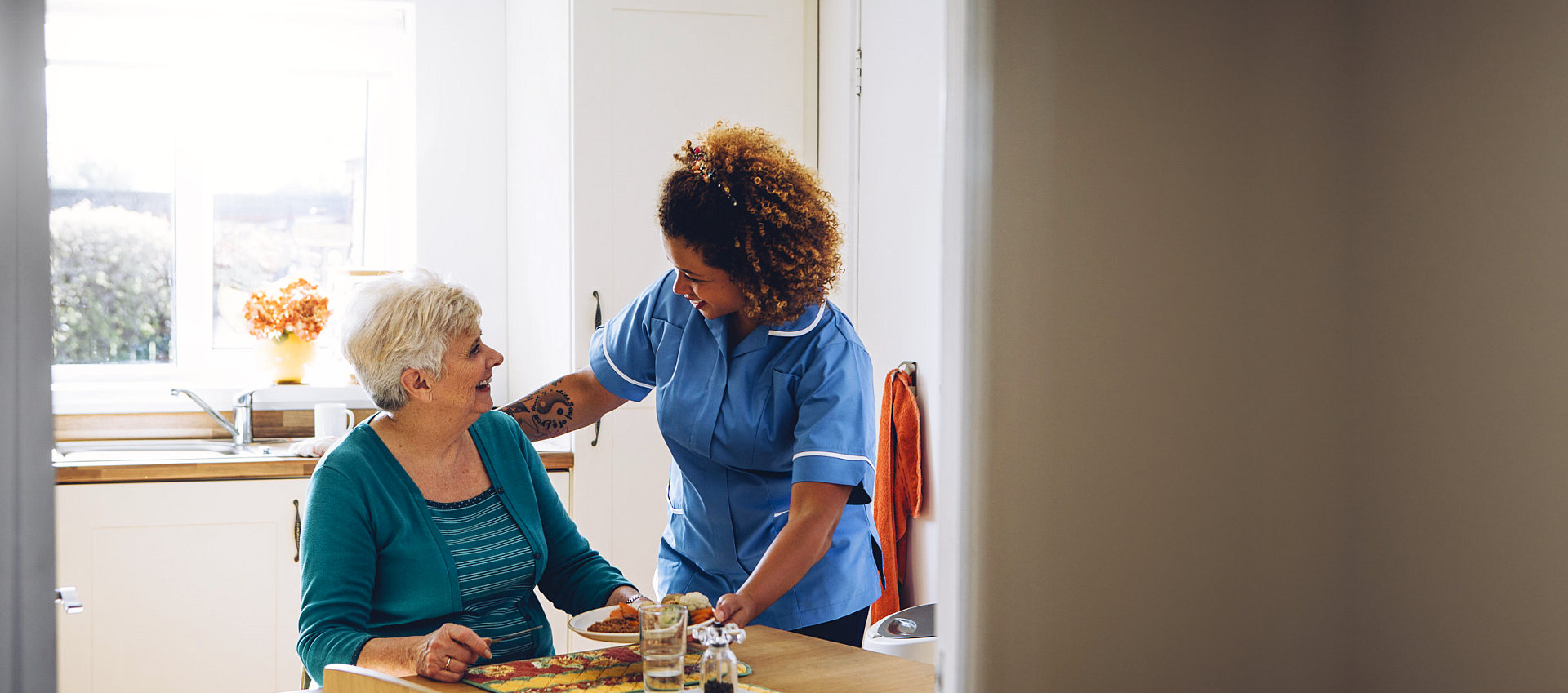 caregiver having conversation with elderly woman